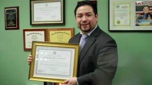 Ceasar B. Malqui with his Diploma as a new Enrolled Agent before the IRS.